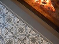 Carrelage imitation carreaux de ciments à Linselles (près de la cheminée)